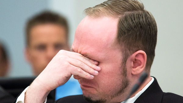 Norwegian Anders Behring Breivik, who is facing terrorism and premeditated murder charges, reacts as a video presented by the prosecution is shown in court, Oslo, Norway, Monday, April 16, 2012.  (AP / Heiko Junge)