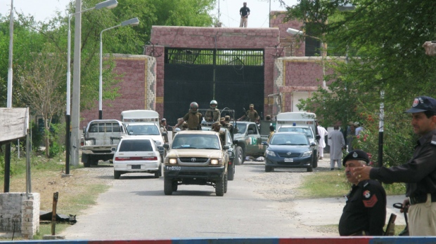Pakistani army troops escort security officials visited the central jail in Bannu, Pakistan, Monday, April 16, 2012. (AP / Ijaz Muhammad)