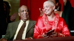 Comedian Bill Cosby, left, and his wife Camille appear at the John F. Kennedy Center for Performing Arts before Bill Cosby received the Mark Twain Prize for American Humor in Washington Oct. 26, 2009.  (AP / Jacquelyn Martin)