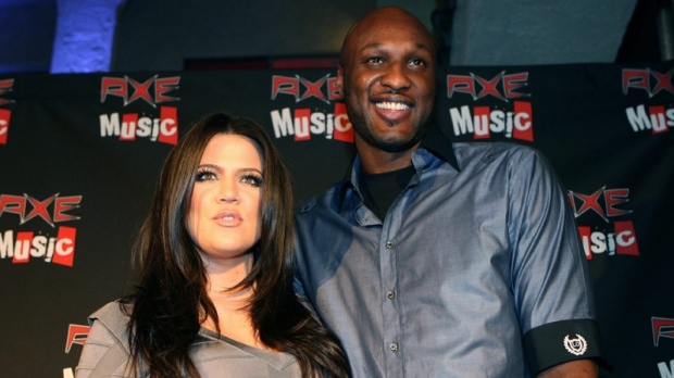 Khloe Kardashian, left, and Lamar Odom arrive at the AXE Music 'One Night Only' concert series featuring Weezer on Tuesday, Sept. 21, 2010 in Los Angeles. (Shea Walsh / AP Images for AXE)