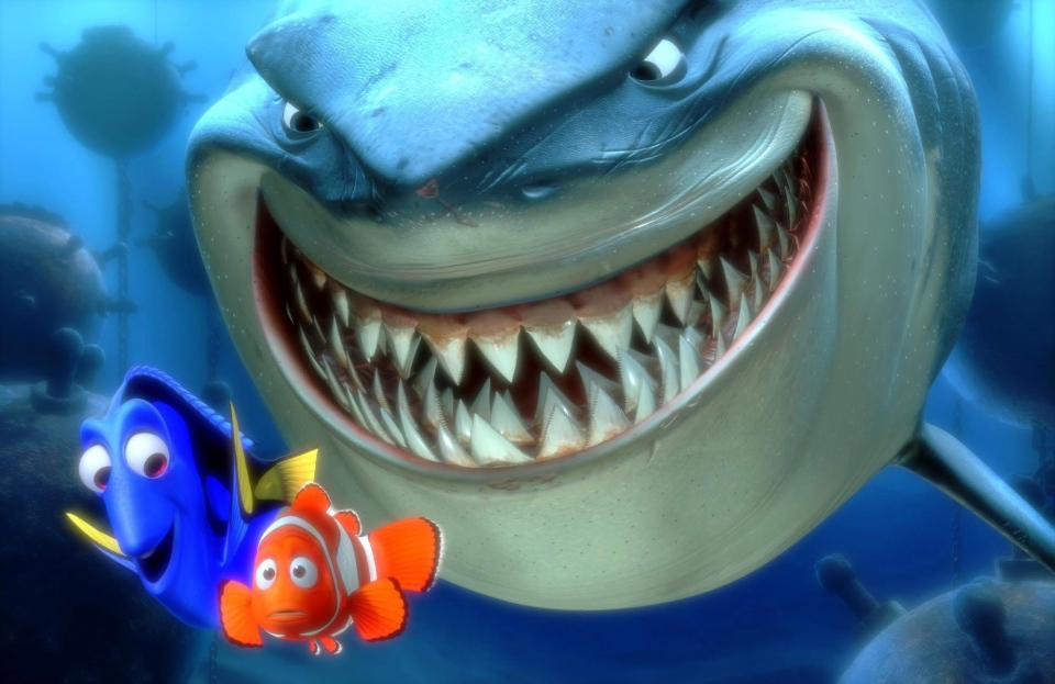 In this promotional photo released by Disney Pixar Animation, Dory, lower left, and Marlin, lower right, face an ocean full of perils in their efforts to rescue Nemo in this scene from Pixar Animation Studios 'Finding Nemo.' (AP / Pixar Animation Studios)