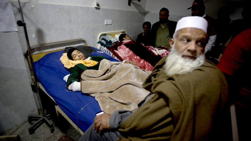 People who survived a Taliban attack on a school receive treatment at a local hospital in Peshawar, Pakistan, Tuesday, Dec. 16, 2014. (AP / B.K. Bangash)
