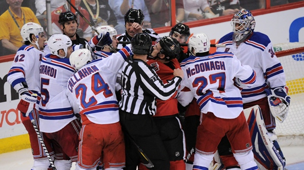 Ottawa Senators scuffle with the New York Rangers during the second period of game three of first round NHL Stanley Cup playoff hockey action at the Scotiabank Place in Ottawa on Monday, April 16, 2012. THE CANADIAN PRESS/Sean Kilpatrick