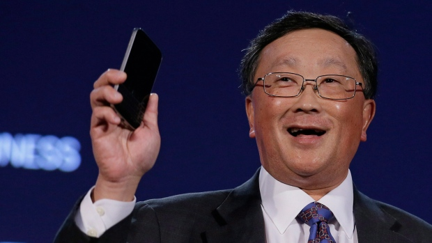 John Chen holds a Blackberry Classic