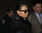 Singer Ashanti leaves the courthouse after testifying at Devar Hurd's trial in New York, Tuesday, Dec. 16, 2014.(AP Photo/Seth Wenig)