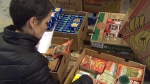 Canadian singer Susan Aglukark packs boxes of food before they are shipped to food banks in Canada's North.