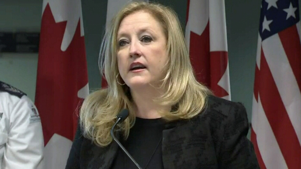 Transport Minister Lisa Raitt speaks to the media at Pearson International Airport in Toronto, Wednesday, Dec. 17, 2014.