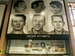 This April 24, 2007 file photo shows an exhibit at the Alcatraz Island museum depicting Frank Morris (left), Clarence Anglin and John Anglin, the only men ever to escape from the prison. The dummy heads they left behind are also shown. (AP / Eric Risberg)