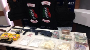 ALERT displays drugs and weapons seized as part of an investigation into the Alberta chapter of the La Familia gang.