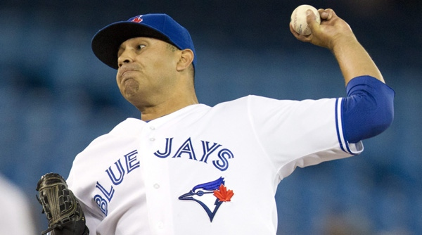 Toronto Blue Jays starting pitcher Ricky Romero pitches to the Tampa Bay Rays during first in the inning of a baseball game in Toronto on Tuesday April 17, 2012. (AP Photo/The Canadian Press, Frank Gunn)