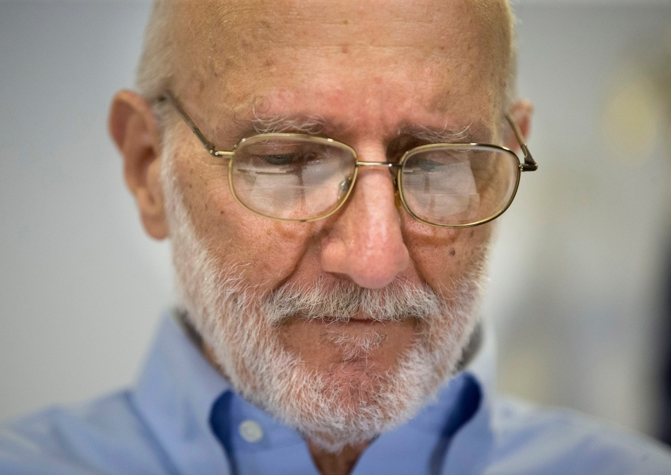 Alan Gross pauses during a news conference at his lawyer's office in Washington on Wednesday, Dec. 17, 2014. Gross was released from Cuba after 5 years in a Cuban prison. (AP / Pablo Martinez Monsivais)