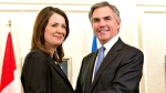 Alberta Premier Jim Prentice and former Wildrose Leader Danielle Smith speak to media after a caucus meeting in Edmonton Alta., Wednesday, December 17, 2014. (Jason Franson / THE CANADIAN PRESS)