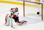 Ottawa Senators goalie Craig Anderson shoots on an empty New Jersey Devils net during the third period of an NHL hockey game, Wednesday, Dec. 17, 2014, in Newark, N.J. The Senators won 2-0. (AP/Julio Cortez)
