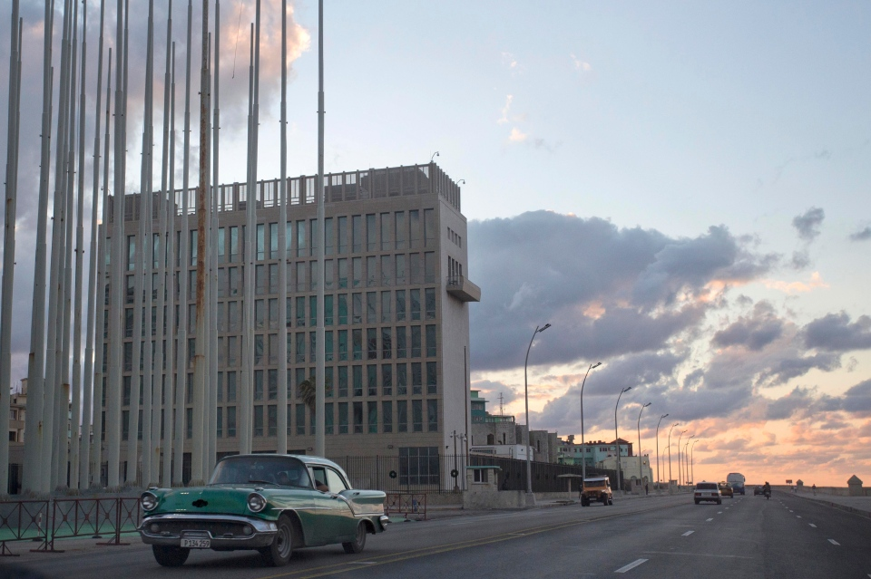 An American classic car passes next to the building of the US Interests Section in Havana, Cuba, Wednesday, Dec. 17, 2014. (AP / Desmond Boylan)