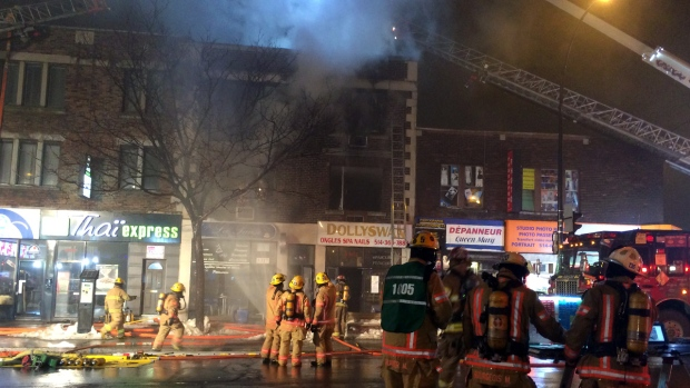 Firefighters battle a building fire on Queen Mary