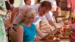 "In this image released by The Weinstein Company, Christoph Waltz and Amy Adams appear in a scene from ""Big Eyes."" (The Weinstein Company, Leah Gallo)"