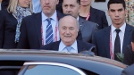 FIFA president Sepp Blatter, centre, leaves a hotel in Marrakech, Morocco, on Dec. 18, 2014. (AP / Christophe Ena)