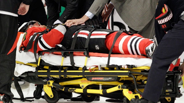 Chicago Blackhawks' Marian Hossa leaves the game after a hit from Phoenix Coyotes' Raffi Torres in Chicago, Tuesday, April 17, 2012. (AP / Nam Y. Huh)