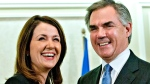 Jim Prentice and Danielle Smith in Edmonton Alta., on Dec. 17, 2014. (THE CANADIAN PRESS / Jason Franson)