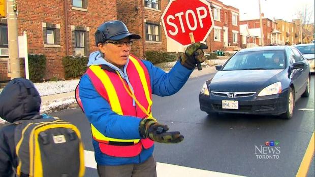 A crossing guard on duty in Toronto