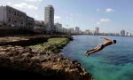 A boy jumps into the water at the Malecon in Havana on Nov. 28, 2011. U.S. President Barack Obama announced Dec. 17, 2104, plans to restore diplomatic ties with the Caribbean island nation. (Javier Galeano / AP Photo)