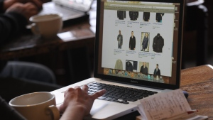 Megan Roney shops online at a coffee house in Denver, Monday, Nov. 28, 2014. (The Denver Post / Helen H. Richardson)