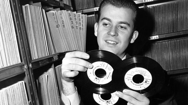 Dick Clark selects a record in his station library in Philadelphia on Feb. 3, 1959. (AP / File)