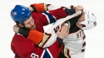 Montreal Canadiens' Brandon Prust and Anaheim Ducks' Clayton Stoner square off during third period NHL hockey action Thursday, December 18, 2014 in Montreal. (Paul Chiasson/THE CANADIAN PRESS)