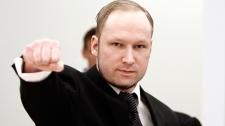 Accused Norwegian Anders Behring Breivik gestures on arrival at the courtroom, in Oslo, Norway, Wednesday April 18, 2012.  (Lise Aserud/Scanpix Norway)