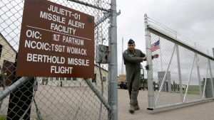 Capt. Robby Modad closes the gate at an ICBM launch control facility outside Minot, N.D., on  June 24, 2014. (AP / Charlie Riedel)
