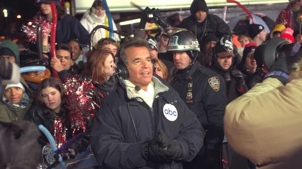 Dick Clark broadcasts during New Year's festivities from Times Square in New York on Dec. 31, 1996. (AP / Wally Santana)