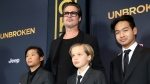 Pax Jolie-Pitt, from left, Brad Pitt, Shiloh Jolie-Pitt and Maddox Jolie-Pitt arrive at the Los Angeles premiere of 'Unbroken' at TCL Chinese Theatre on Monday, Dec. 15, 2014. (Matt Sayles / Invision)