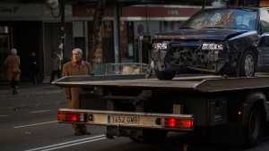 A truck removes a crashed car in Madrid, Spain, Friday, Dec. 19, 2014. (AP / Andres Kudacki)