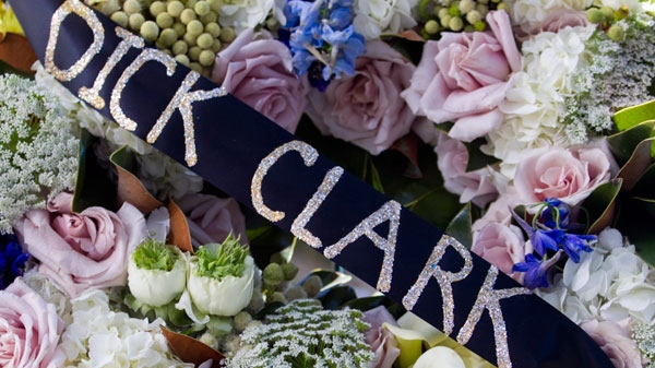 A wreath of flowers is laid at the star honoring television host Dick Clark on the Walk of Fame in Los Angeles Wednesday, April 18, 2012. (AP / Damian Dovarganes)