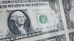 A sheet of U.S. one dollar bills.