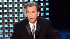 Dick Clark speaks after receiving a special Emmy tribute at the 58th Annual Primetime Emmy Awards in Los Angeles, Sunday, Aug. 27, 2006. (AP / Chris Carlson)