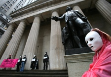 Protesters with Code Pink rally against Wall Street bailouts at the New York Stock Exchange, in front of a statue of George Washington and Federal Hall, Friday, Sept. 26, 2008. (AP / Mark Lennihan)