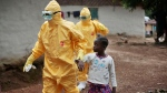 Nowa Paye is taken to an ambulance after showing signs of Ebola in Freeman Reserve, Liberia, on Sept. 30, 2014. (AP Photo / Jerome Delay)