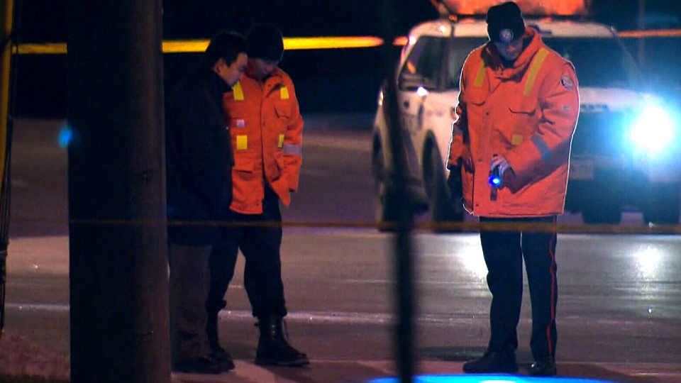 Police are shown investigating a traffic fatality near Finch Avenue East and Neilson Road on Friday, Dec. 19, 2014 after a 14-year-old girl was struck and killed. Police confirmed Saturday that the vehicle involved was a TTC bus.