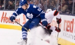 Maple Leafs defenceman Jake Gardiner (51) tries to check New Jersey Devils forward Jacob Josefson, right, in Toronto, on Thursday, Dec. 4, 2014. (The Canadian Press / Nathan Denette)