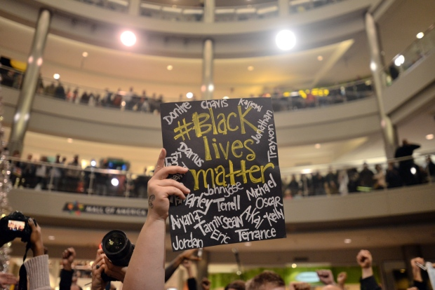 """Demonstrators filled the Mall of America rotunda and chanted """"Black lives matter"""" to protest police brutality, Saturday, Dec. 12, 2014, in Bloomington, Minn. The group Black Lives Matter Minneapolis had more than 3,000 people confirm on Facebook that they would attend. Attendance figures weren't immediately available. (APThe Star Tribune, Aaron Lavinsky)"""