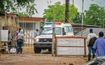In this file photo taken Sunday, Aug. 10, 2014, an ambulance leaves the Ebola isolation unit carrying the bodies of Ebola victims that are highly contagious to a burial site outside Freetown in Kenema, Sierra Leone. (AP Photo/ Michael Duff)