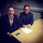 David Furnish and Elton John sign a marriage document on Sunday, Dec. 21, 2014 in Windsor, England. (Instagram / Elton John)