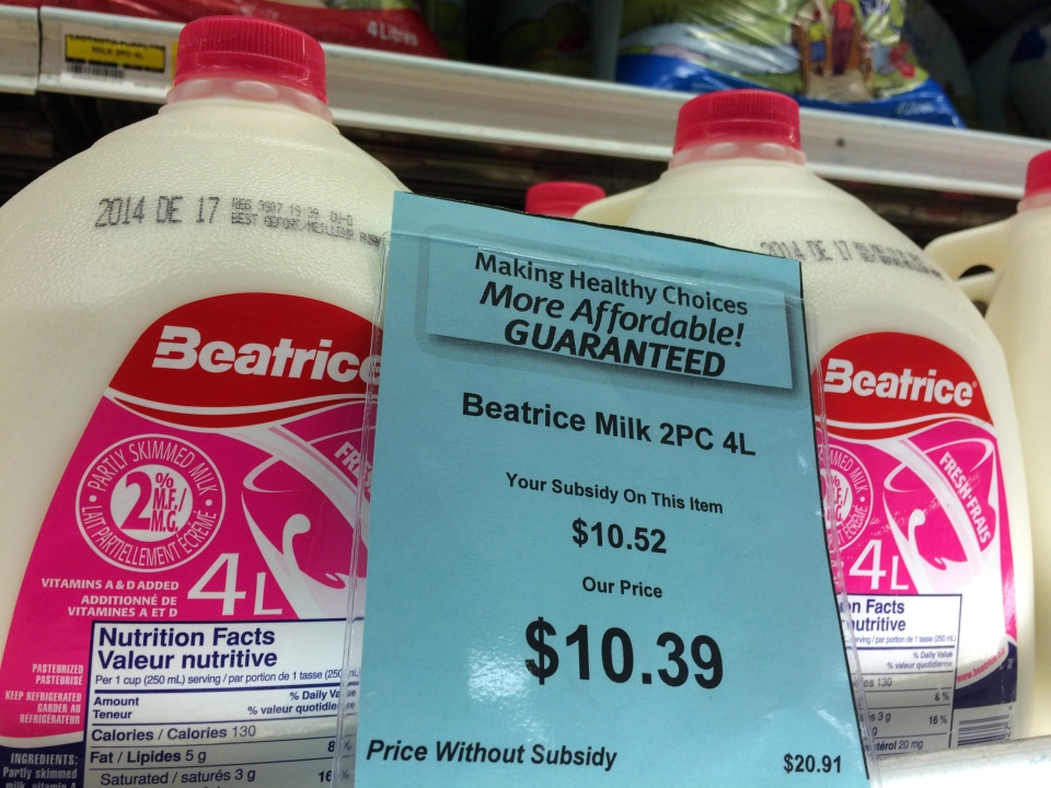 A price tag lists the price and subsidy of a 4 L jug of milk at a grocery store in Iqaluit, Nunavut on Monday, Dec. 8, 2014. (Sean Kilpatrick / THE CANADIAN PRESS)