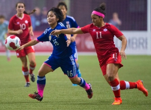 Team Canada's Desiree Scott, right, fights for control of the ball with team Japan's Mana Iwabuchi during first half International friendly soccer action in Vancouver, Tuesday, Oct., 28, 2014. (Jonathan Hayward / THE CANADIAN PRESS)