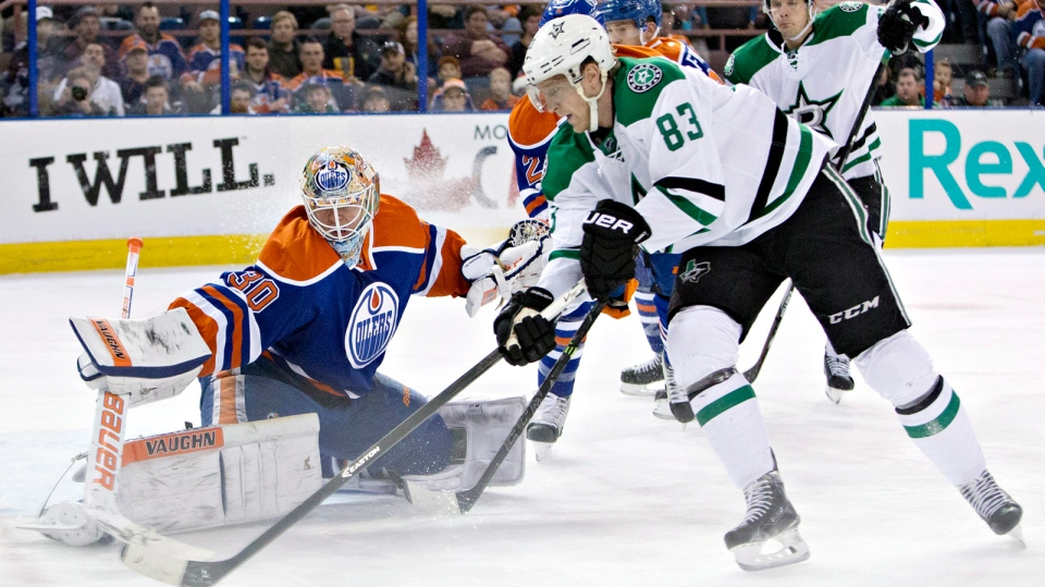 Dallas Stars' Ales Hemsky is stopped by Edmonton Oilers goalie Ben Scrivens during first period NHL hockey action in Edmonton, Alta., on Sunday December 21, 2014. (Jason Franson/THE CANADIAN PRESS)