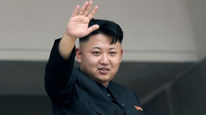 In this July 27, 2013 file photo, North Korea's leader Kim Jong Un waves to spectators and participants of a mass military parade celebrating the 60th anniversary of the Korean War armistice in Pyongyang, North Korea.