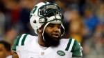 In this Nov. 24, 2014, file photo, New York Jets defensive end Sheldon Richardson watches during warmups before an NFL football game against the Buffalo Bills in Detroit. (AP/Paul Sancya, File)