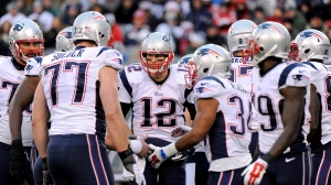 New England Patriots quarterback Tom Brady talks to his team in the huddle during the second half of an NFL football game Sunday, Dec. 21, 2014, in East Rutherford, N.J. (AP/Bill Kostroun)