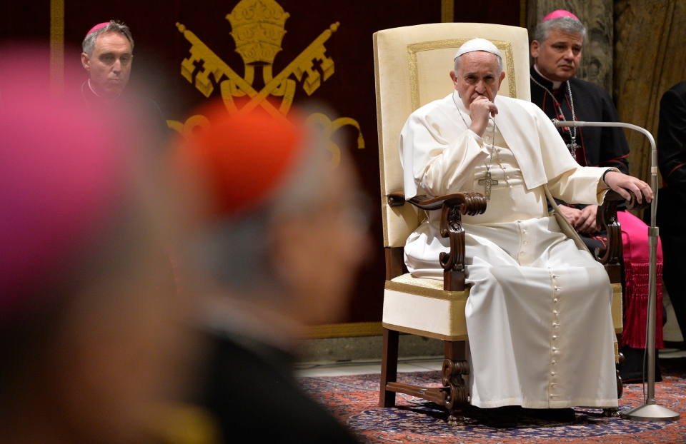 Pope Francis meets with Cardinals and Bishops of the Vatican Curia on the occasion of the exchange of Christmas greetings in the Clementine hall at Vatican, Dec. 22, 2014. (AP / Andreas Solaro)